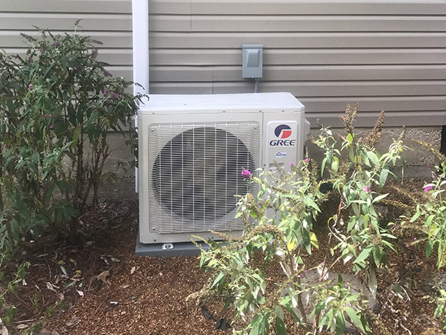 Outside heat pump condenser for ductless heat pump