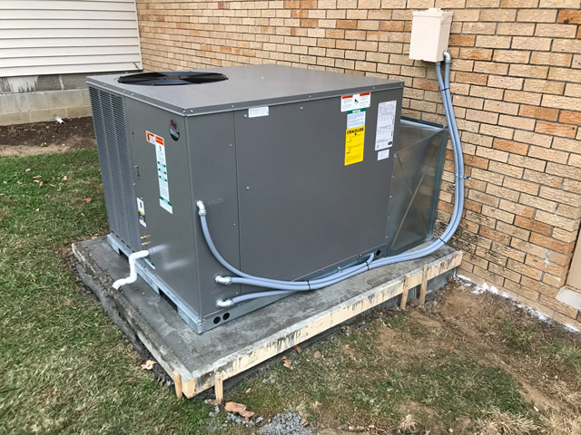New Heat Pump Package unit with a new poured concrete pad